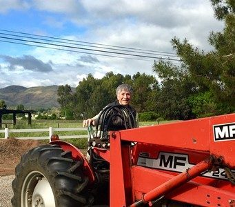 Helen James sitting at the controls of her tractor