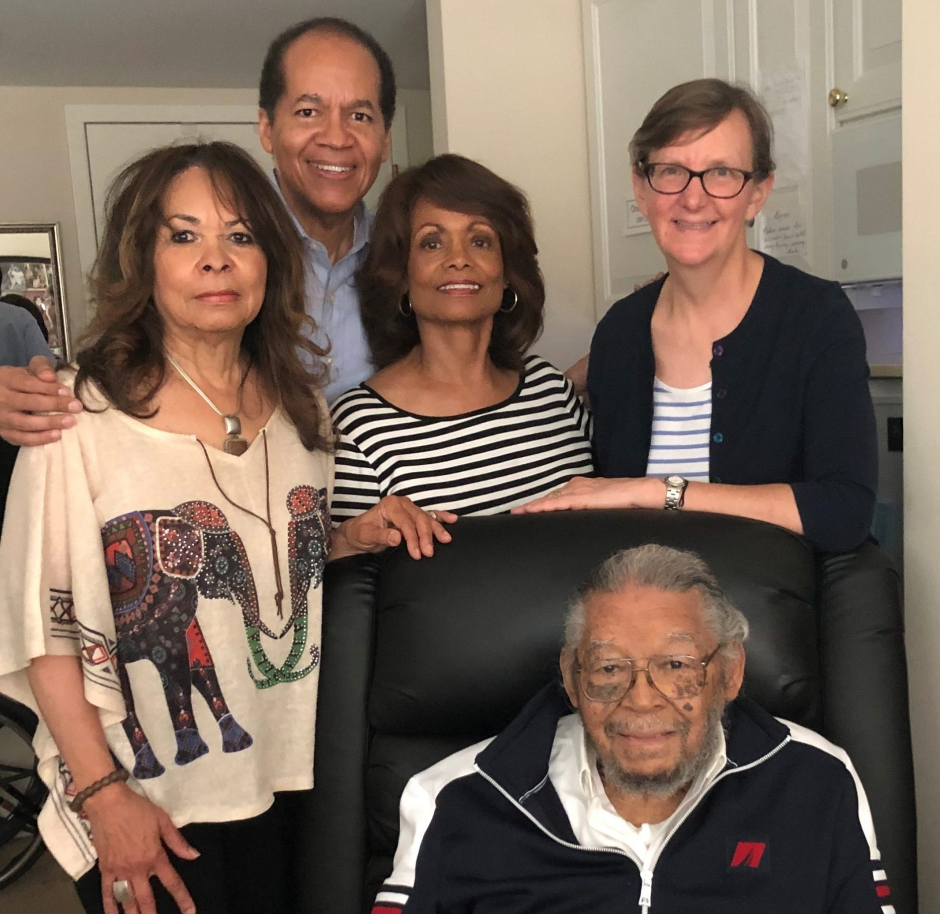 Nelson (seated) with family and LAAW attorney Elizabeth Kristen